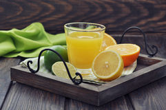 Citrus juice and fruits Royalty Free Stock Photos