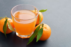 Citrus juice in glass Royalty Free Stock Image