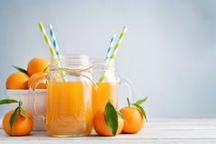 Citrus juice in jar Stock Images