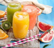 Citrus juice   on  wooden board Stock Images