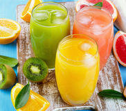 Citrus juice   on a wooden board Royalty Free Stock Images