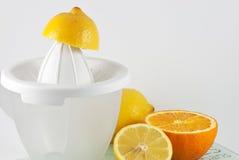 Citrus juicer. Lemons and oranges with citrus juicer Stock Photo