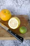 Citrus with knife Stock Photos