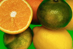 Citrus: lemon, orange, mandarin,green background Stock Photo