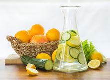 Citrus lemonade in glass jug on table Stock Images
