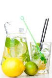Citrus lemonade in pitcher and glass Stock Photos