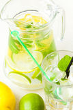 Citrus lemonade in pitcher and glass , closeup Stock Photography
