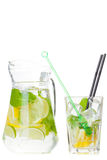 Citrus lemonade in pitcher and glass , closeup Stock Images