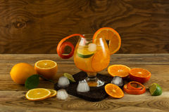 Citrus lemonade on wooden background Royalty Free Stock Photo
