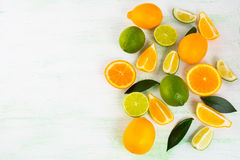 Citrus on light green background Royalty Free Stock Photography