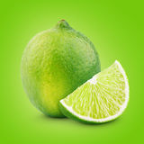 Citrus lime fruit with slice Royalty Free Stock Image
