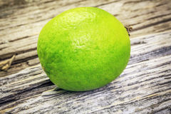 Citrus lime fruit on a wooden boards Royalty Free Stock Photos