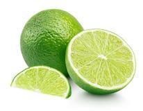 Citrus limefruktfrukt med skivan och halva som isoleras på vit Arkivfoto