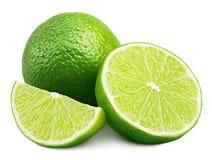 Citrus limefruktfrukt med skivan och halva som isoleras på vit arkivbilder
