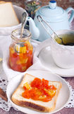 Citrus marmalade on bread Stock Photography