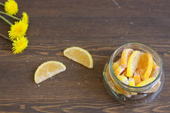 Citrus marmalade and dandelions. Citrus marmalade, tasty sweet desert stock photos