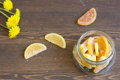 Citrus marmalade and dandelions. Citrus marmalade, tasty sweet desert stock images