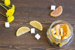 Citrus marmalade and dandelions. Citrus marmalade, tasty sweet desert royalty free stock photo