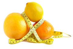 Citrus and measure tape. On white Royalty Free Stock Image