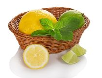 Citrus and mint in the wicker basket Royalty Free Stock Photo