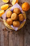 Citrus muffins and fresh oranges close-up. Vertical top view Stock Photo