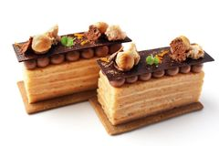 Citrus Opera cakes with hazelnuts and chocolate ganache stock images