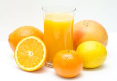 Citrus and orange juice. Ripe and juicy citrus fruit - lemon, orange and grapefruit. As well as freshly squeezed orange juice. Perfect for fructarians royalty free stock photography