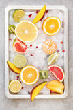 Citrus and other fruits on ice Stock Photography