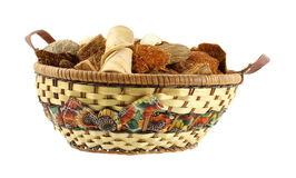 Citrus potpourri in wicker basket. A colorful wicker basket filled with citrus potpourri against a white background stock photography