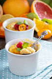 Citrus pudding in smal ramekins Stock Photography