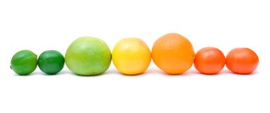 Citrus rainbow. Limes,green and yellow grapefruits, orange and mandarines isolated on white background Royalty Free Stock Photography
