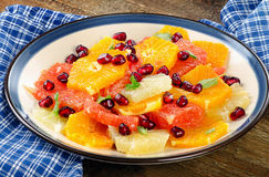 Citrus Salad with pomegranate seeds. Stock Photo