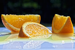 Citrus slice. Cut wedges of orange lying randomly on a board Royalty Free Stock Images