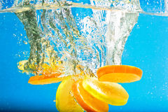 Citrus slice SPLASHING IN WATER Royalty Free Stock Image