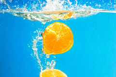 Citrus slice SPLASHING IN WATER Royalty Free Stock Photo