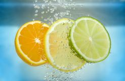 Citrus slice in water Royalty Free Stock Photography