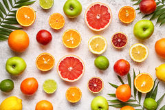 Citrus sliced harvest fruits background flat lay, helthy vegetarian organic food royalty free stock photography