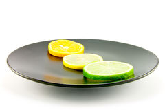Citrus Slices on a Black Plate Royalty Free Stock Image
