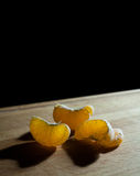Citrus slices on cutting board. Macro view. Soft focus. Black background, copy space Royalty Free Stock Photo