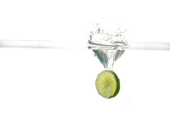 Citrus Splash. Fruit dropping into water with a splash Stock Photos
