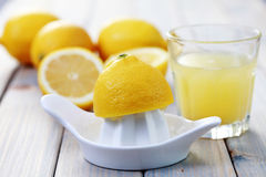Citrus squeezer. And fresh lemon juice - food and drink Stock Photography