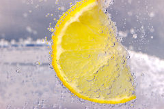 Citrus squeezer with lemons Royalty Free Stock Photo