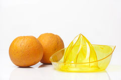 Citrus squeezer with oranges on white background Royalty Free Stock Photos