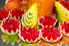 Citrus table decoration. Beautifully cuted grapefruits and lemon Stock Photo