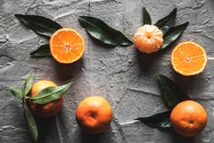Citrus on table: mandarin, tangerine with a knife. Fresh organic juicy fruits. Stock Photos