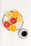 Citrus variety served for breakfast. Colorful kaleidoscope. A cup of Arabica coffee and some fresh cut grapefruits and oranges placed neatly and being served on Royalty Free Stock Photo