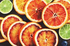 Citrus vitamin mix - bloody oranges and limes, top view Stock Photos