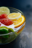 Citrus in water with bubbles in transparent plate Oranges, lemon Stock Photo