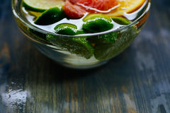 Citrus in water with bubbles in transparent plate Oranges, lemon Royalty Free Stock Photography