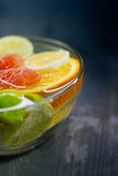 Citrus in water with bubbles in transparent plate Oranges, lemon Royalty Free Stock Images